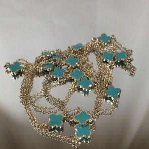 """Jewelry - Quatrefoil motif, gold tone necklace. 52"""" long."""